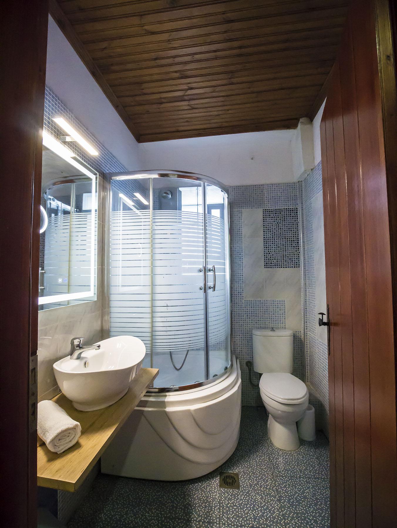 konaki hotel mansion superior room accommodation tsagarada mylopotamos pelion fireplace greece travel 04